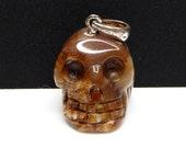 Petrified Wood Carved Crystal Skull Pendant