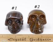 Tiger Iron Mugglestone Carved Crystal Skull