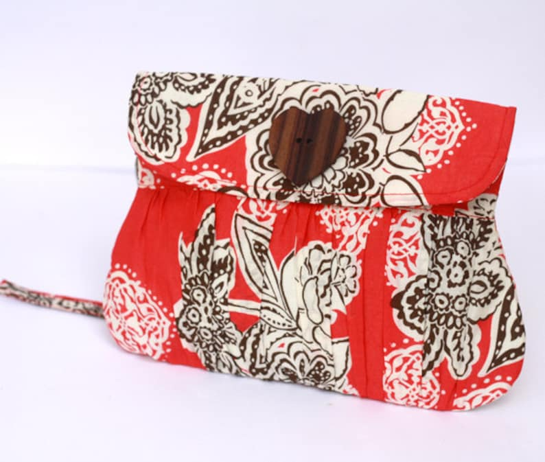 Wristlet Pleated Wristlet In Coral and Brown Flower with image 0