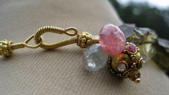 ANANDINI  Olive Tourmaline, 18k Gold, with Navaranta Charm Necklace
