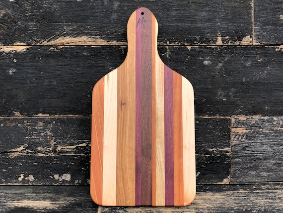 Handmade hardwood cutting board made from walnut, cherry, maple, purple heart, birch and oak woods