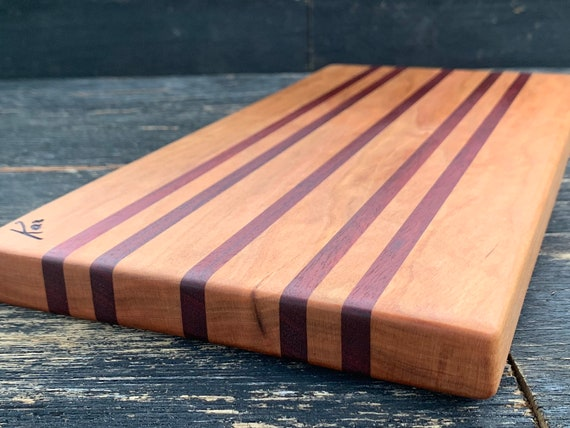 Cutting board made from cherry and bloodwood.