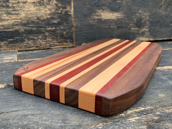 Cheese board made from walnut, cherry and purple heart woods