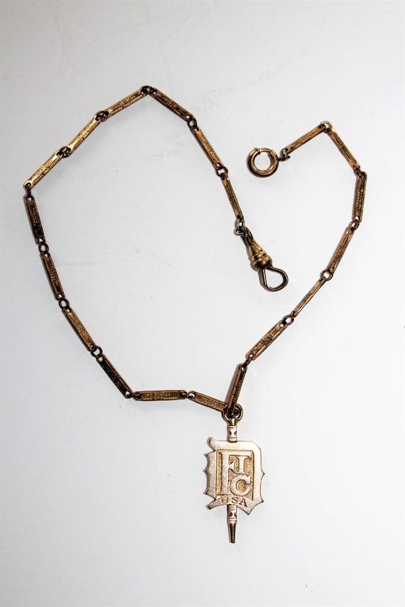 Antique Pocket Watch Chain with 10K Gold F.I.C. Watch Fob 1910s