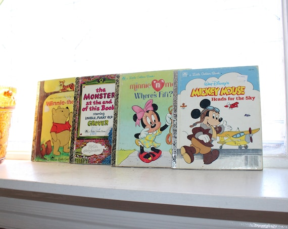 4 Little Golden Books Mickey Mouse Sesame Street Winnie the Pooh