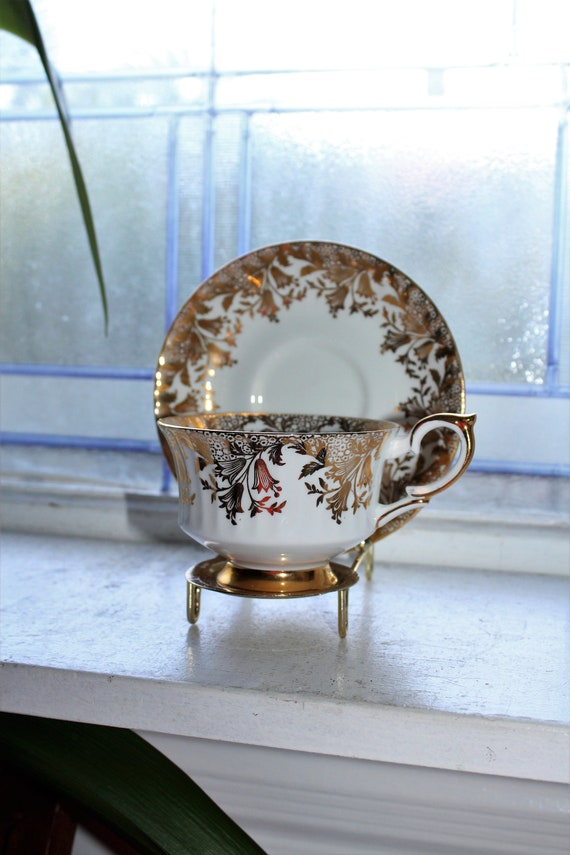 Paragon Tea Cup and Saucer Gold and White Vintage Bone China