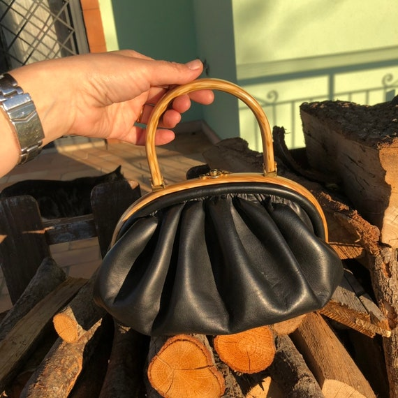 Leather puffy bag 1940s