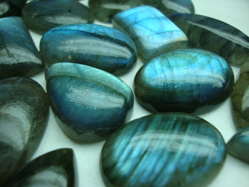 Labradorite Blue Cabochons Very Rare flashy blue fire Wt 587 cts Pcs 28 huge size Wholesale price Good Sizes Mix shapes Ovals Pears