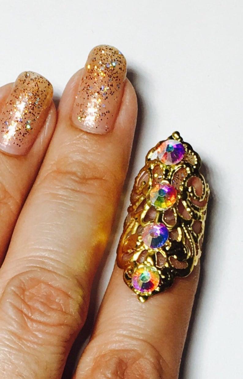 Single crystal claw ring,nail ring ail tip,nail cover,gold filigree and adorned with clear ab crystals. nail guard