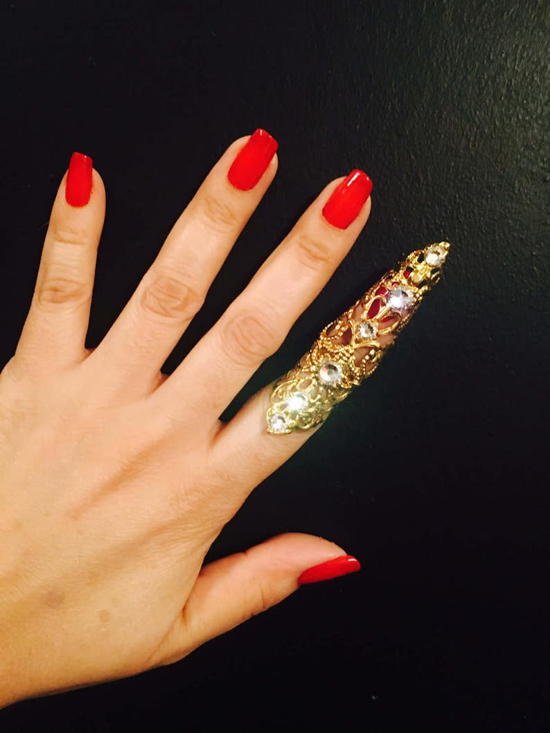 Only made in gold color with clear crystals nail guard,finger tip Double arrow claw ring sizable. 1 pc
