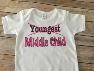 Youngest to Middle child one piece or t shirt (Custom Text ColorsWording)
