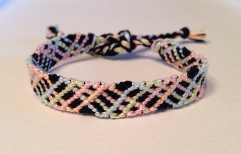 2aeeba759a6b3 Pastel Blue, Green, Pink, and Orange Zig Zag on Black - Friendship Bracelet
