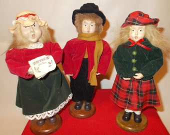 three vintage christmas carolers are traditional holiday decoration for victorian christmas decor