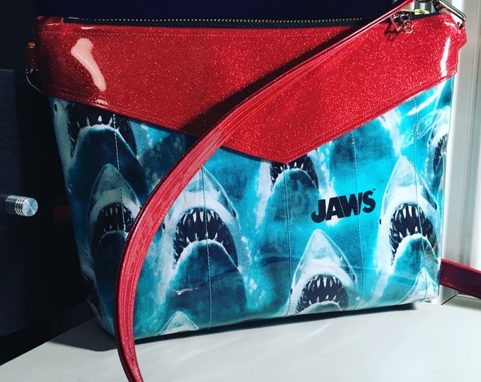 Vegan clutch/crossbody purse in a red sparkle vinyl and shark fabric