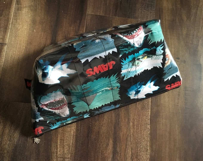 Zippered makeup bag in a Jaws shark fabric with clear vinyl top layer