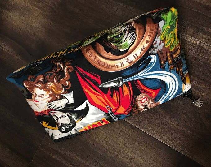 Zippered makeup pouch or diabetic supply bag in a retro monster fabric