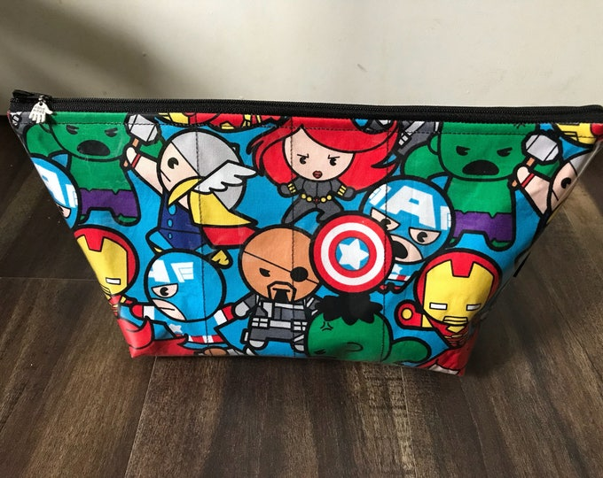 Zippered makeup bag in a kawaii marvel  fabric with clear vinyl top layer