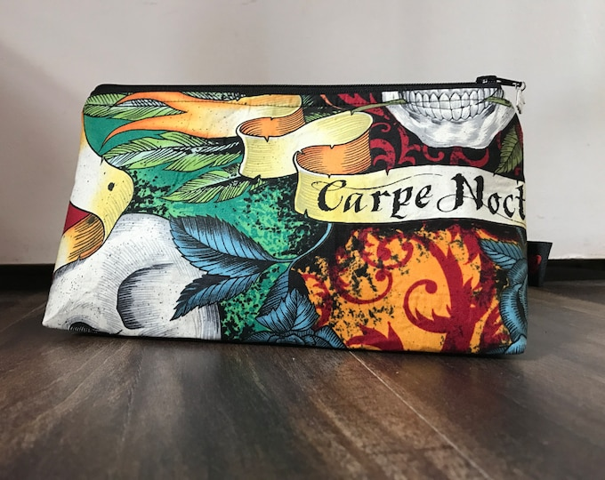 Zippered makeup pouch in a seize the night (carpe noctem) skull fabric