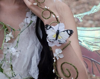 Green and white butterfly arm cuff