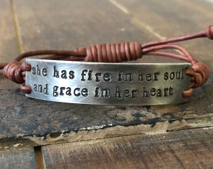 Featured listing image: She has fire in her soul and grace in her heart Bracelet, silver, Pewter, leather, Hand Stamped, Inspirational jewelry, bracelet with words,