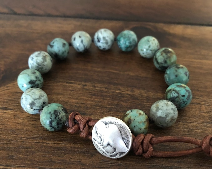 green turquoise gemstone bracelet with a silver buffalo clasp