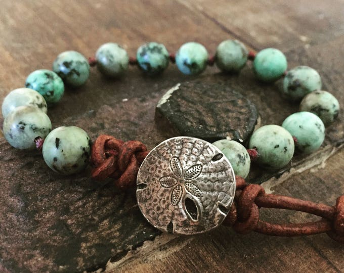 green turquoise gemstone bracelet with a silver sand dollar clasp