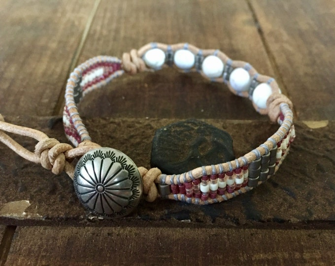 Native American inspired beaded leather bracelet with silver clasp