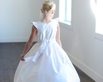 First Communion Dress or Flower Girl Dress in white pure silk and available in 140 different silk colours