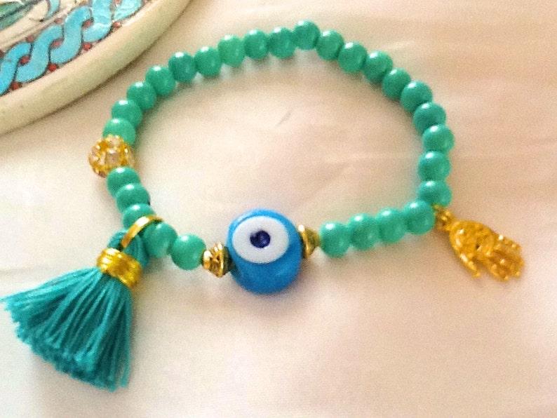 8f9ea52e75b0 La pulsera amuleto verde con borla mal de ojo Turco pulsera