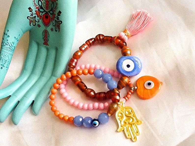 dd51e7e55115 Bohemian evil eye and Hamsa bracelet with tassel Ethnic