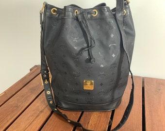 a73dfe04f7e15 MCM Hard to Find Vintage Authentic Black Canvas and Leather Trim Drawstring  Shoulder Bag