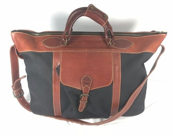 ea41b93513d TIMBERLAND Made in England Vintage Authentic Brown leather Trim and Black Canvas  Weekender Duffle Bag Travel Bag