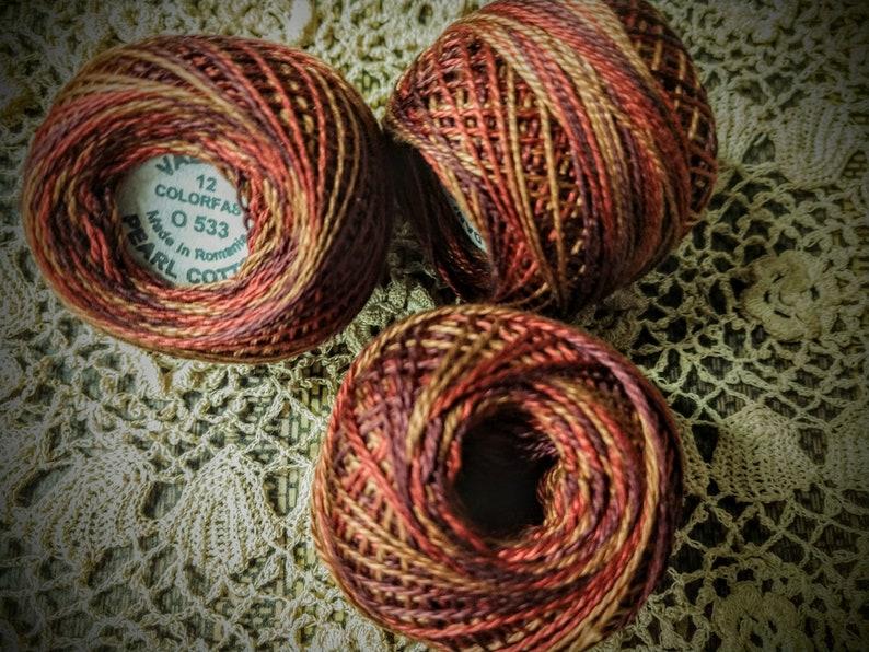 Burgundy to gold Valdani Perle Cotton Size 12 0533 Golden Autumn color Golden reds