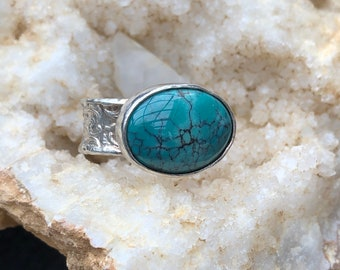 Beautiful turquoise ring in textured sterling silver.