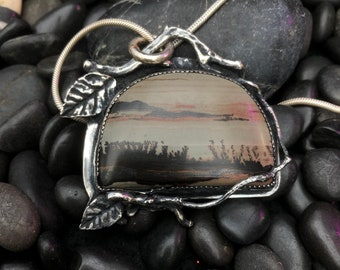 This dendritic rhyolite makes a beautiful sterling landscape pendant.