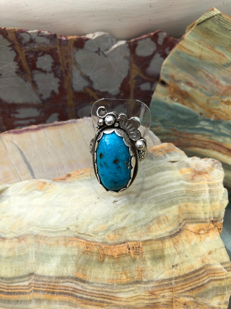 Ithaca Peak Turquoise scalloped statement ring size 8 with handmafe silver floral embellishments.