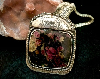 My Secret Garden pendant. Gorgeous Floral stone. The flowers are ruby,