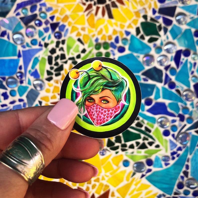 Mask Babe wear a mask love bug 2\u201d vinyl circle sticker art by Jaymee Laws Mini Sticker