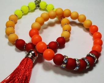 Acrylic beade bracelets with charms and tassel