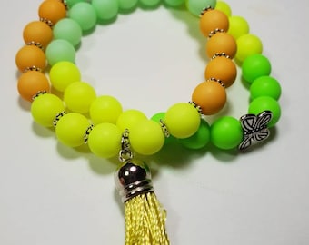 Acrylic bright colours bracelets with charms