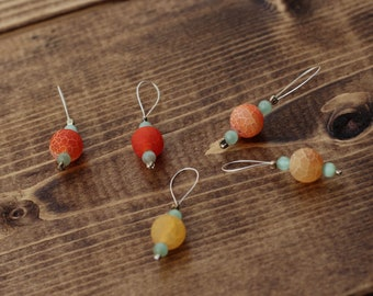 orange and yellow crackle glass beads. Stitch markers for knitting and crochet