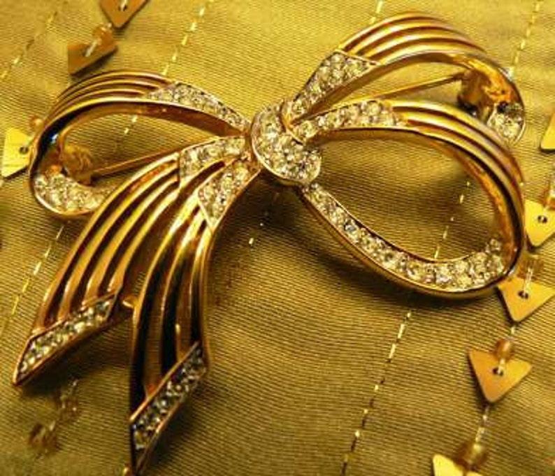 vintage jewels ... DORLAN Darling BOW rhinestone Brooch PIN image 0