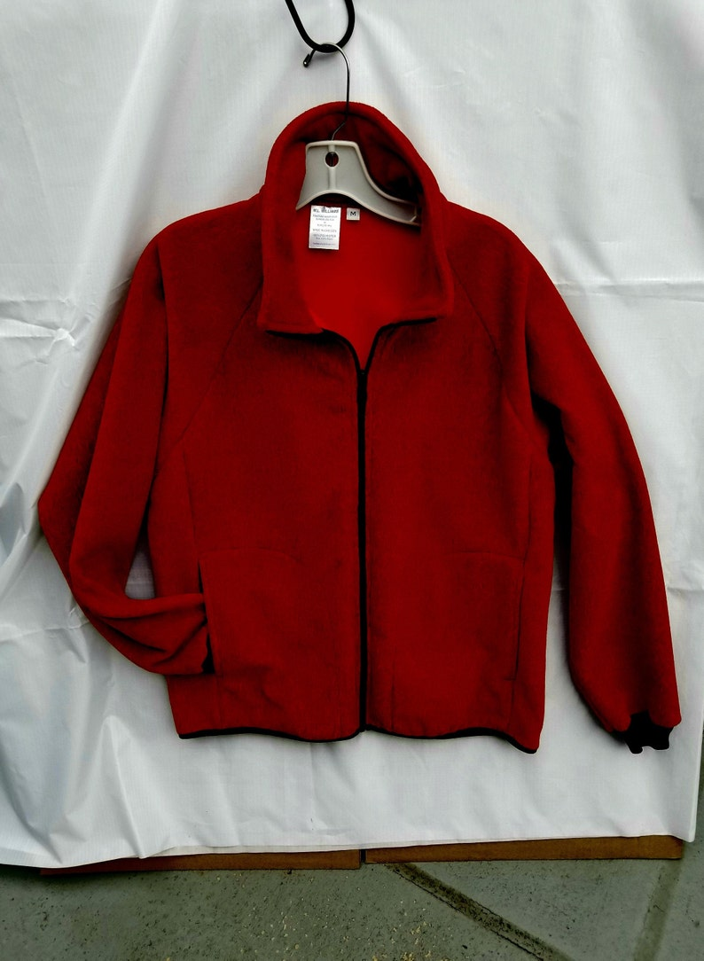 . Inside zip pocket. Small or Medium FIRECRACKER Red Polartec Fleece Jacket. Unisex size.