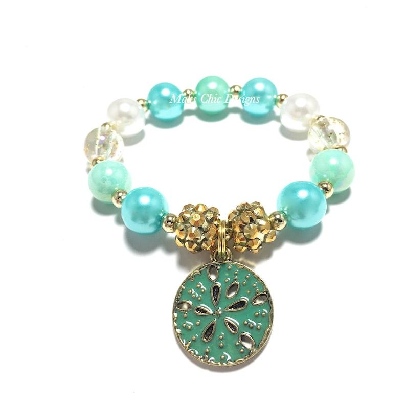 Sand Dollar Charm Bracelet Gold and White Bracelet Beach Birthday Aqua Girls Blue Mermaid Shell Bracelet Blue Beach Bracelet