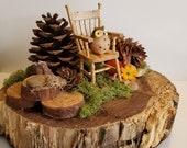 Little Folk Woodland Critters nature diorama Wisely Resting featuring Mr. Owl in his rocking chair, pinecones, twigs on a walnut slab