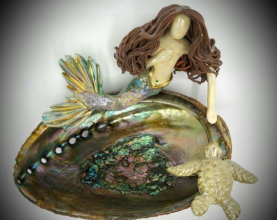 Brunette Mermaid sitting upon an Abalone shell