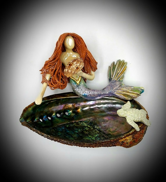 Redhead Mermaid sitting upon an Abalone shell