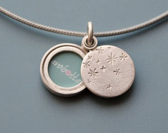small romantic sterling silver photo locket with starry night design