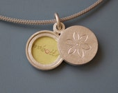 small sterling silver locket for two pictures - dainty flower double locket