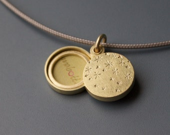 beautiful golden locket for two pictures with starry night design